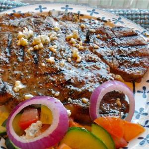 Greek Seasoned Porterhouse with Cucumber and Tomato Salad