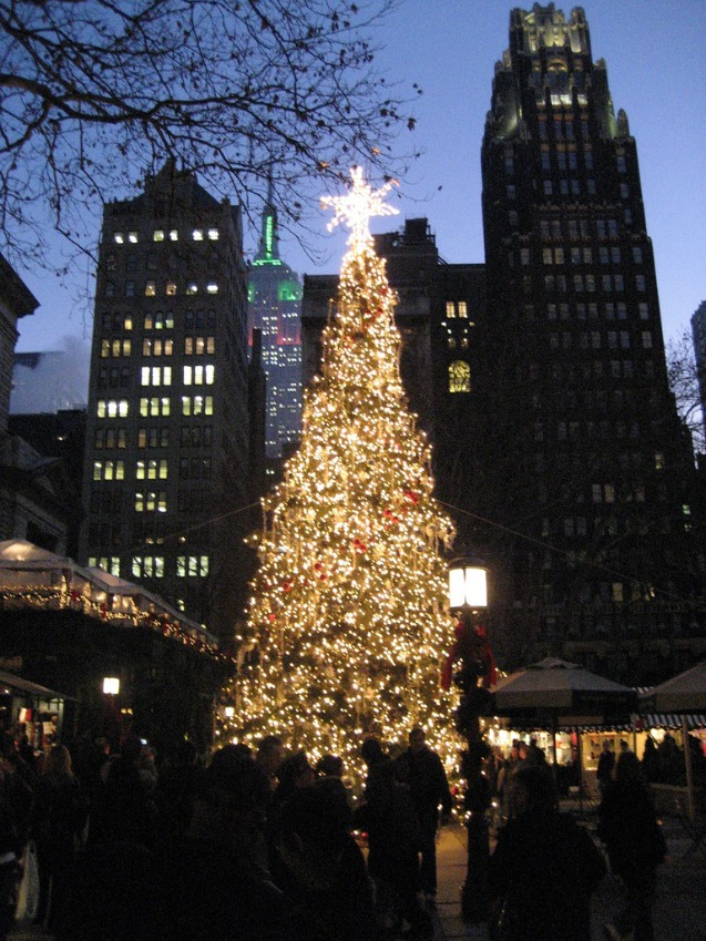 Christmas Tree at Bryant Park in NYC with Empire State Building in the background.